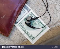 money under wallet on ground earphones ear phones tiny small