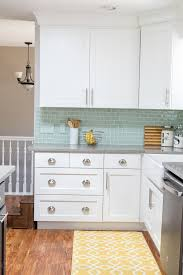 white kitchen cabinets with aqua backsplash kitchen reveal before and after photos home kitchens