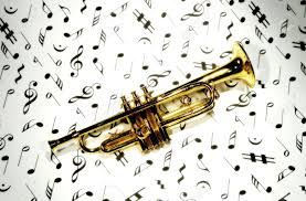 photo of a trumpet on musical notes stock photo picture and