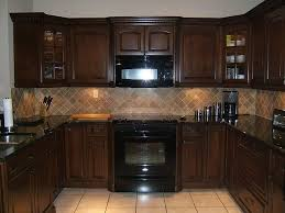 what color tile goes with brown cabinets kitchen backsplash ideas with brown cabinets brown