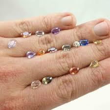 coloured sapphire rings images Designer fraser hamilton 9ct gold hands solitaire bi colour jpg