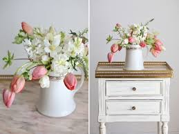 the prettiest spring wedding centerpiece with tulips in a pitcher
