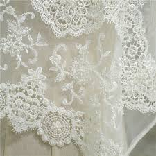 ivory hollow floral patterned embroidered lace fabric with pearls