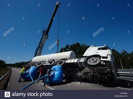 Mobile K He People Try To Turn An Overturned Tanker Truck With The Help Of A