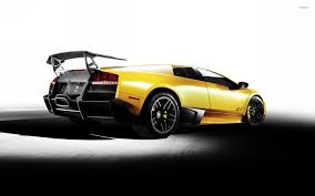 yellow lamborghini back side view of a yellow lamborghini murcielago wallpaper car