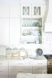 soothing summer home tour 2017 neutral transitional home decor to create a soothing feel in our kitchen i kept the decor simple and fresh more blue and white ginger jars and some fresh fruit give our kitchen a relaxed