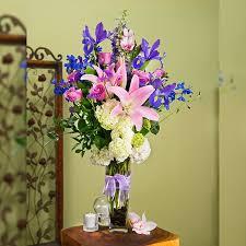 bobbie tall vase purple flowers lillies iris hydrangeas
