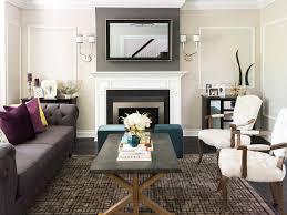 Geometric Area Rug by Purple Throw Pillows Modern Glam Living Room Dark Wood Floors Wall