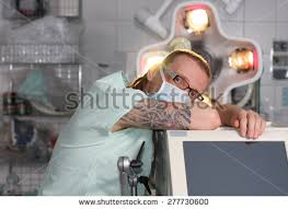 portrait male nurse icu tattoo dreadlocks stock photo 277730594