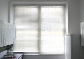 wood venetian blinds with single valance for large kitchen window