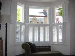 the perfect blinds and shutters for a bay window