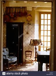 Country Dining Rooms by View Through Open Doorway To English Country Dining Room With