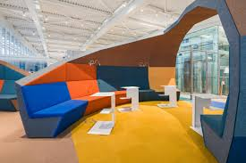 a colorful airport lounge designed to excite design milk