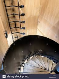 White Oak Veneer White Oak Veneer And Black Steel Spiral Staircase The Angled