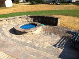 Unilock Patio Designs by Grow Rite Design Unilock Partnered With A Gas Firepit Brick