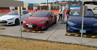 tesla charging tesla vehicles arrive 20 minutes after charging stations open