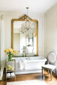 bathroom cabinets mini crystal chandelier over white oval