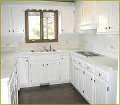 Painted White Kitchen Cabinets Before And After Before And After Painting Knotty Pine Kitchen Cabinets Hum Home
