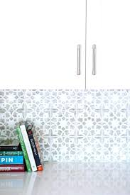 kitchen makeover with hexagon tile backsplash and painted gray