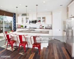 kitchen island with red bar stools in house stock photo getty images