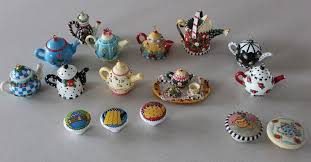 lot of engelbreit teapot ornaments and door knobs