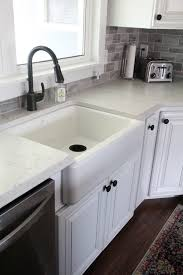 how to install farm sink in cabinet installing a kohler whitehaven sink bright green door