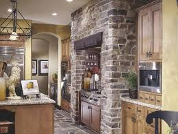 fashionable cobblestone backsplash kitchen with marble countertop