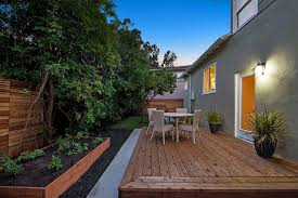 deck with exterior stone floors u0026 raised beds in oakland ca