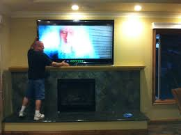 decoration interesting mounting a tv over a fireplace with crown