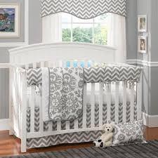 baby bedding sets gender neutral white wooden nursery shelves pad