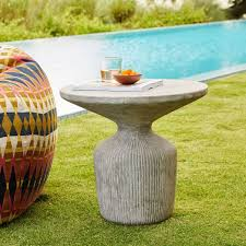 power of books sculptural glass topped side table tambor concrete outdoor drum side table west elm