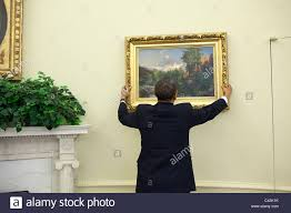 Oval Office Decor By President President Barack Obama Adjusts A Painting In The Oval Office Stock