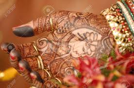 heena and ornaments on palm of in indian hindu wedding