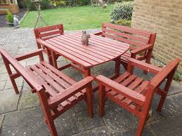wooden garden furniture set comprising table 2 bench seats and 2