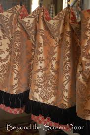 brown red and gold window treatments beyond the screen door
