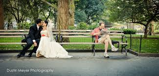 indian wedding photographer nyc an indian wedding spontaneously kisses on a park bench in