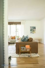 freshly painted white living room bigger than the three of us modern boho living room with freshly painted white walls