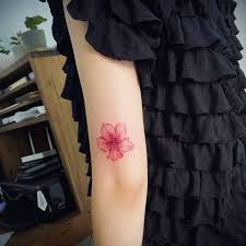 flower tattoo on the tricep