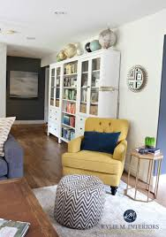 ikea hemnes bookcases in family room with chartreuse accent chair