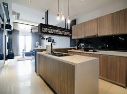 the kitchen uses a mix of light timber laminate finishing matched