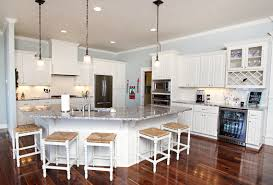 affordable custom cabinets showroom thumb kitchen traditional style painted raised panel angled island glass doors wine rack wood hood staggered