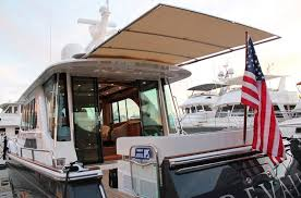 Sailboat Awning Sunshade Sureshade Extending The Experience Telescoping Boat Shades