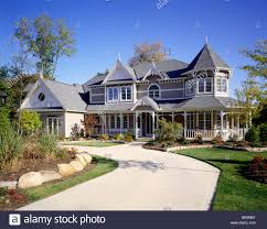 victorian style house victorian style house with curved concrete driveway stock photo