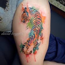 watercolor tattoo of crawling tiger on leg tattoos pinterest