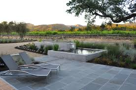 Backyard Oasis Ideas by Decorating Chaise Lounge On Bluestone Pavers As Exterior Seating