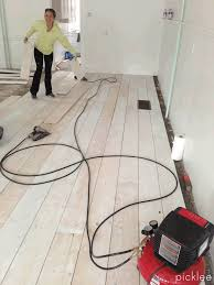 How To Clean Laminate Floors So They Shine Farmhouse Wide Plank Floor Made From Plywood Diy Picklee