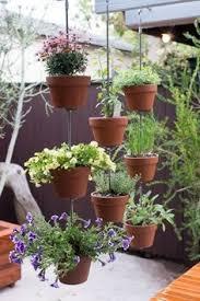 this vertical clay pot garden can move with you diy vertical