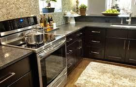 kitchens with dark cabinets and light countertops round shade