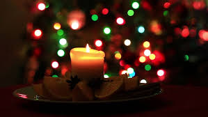 of candle on blurred blinking lights stock footage