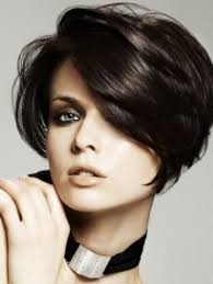 cut and style side bangs fine hair tousled dark bob haircut with side part and long side swept bangs